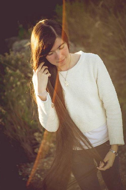 Nastolatka znajdłuższymi włosami